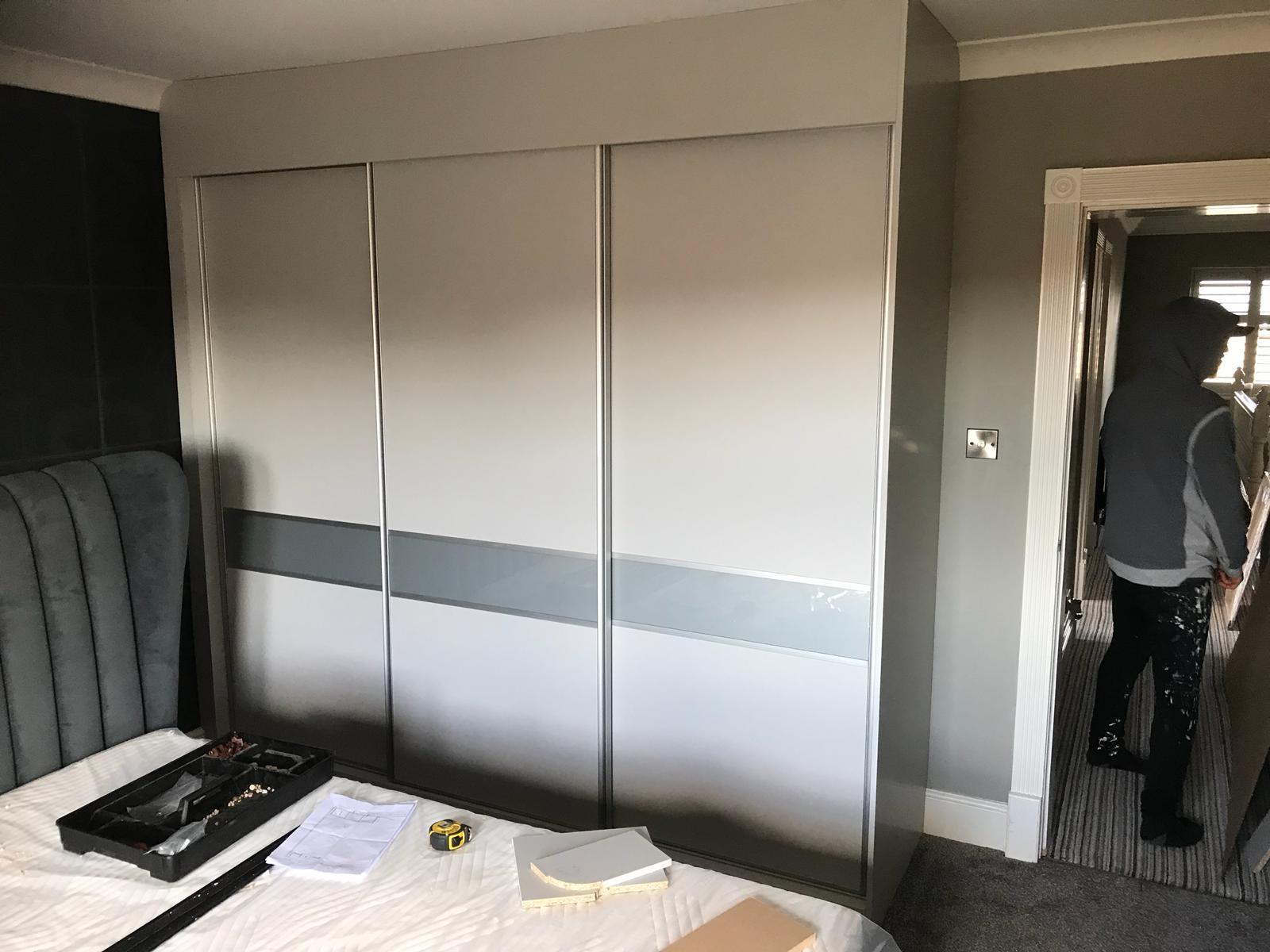 Custom built wardrobe with sliding doors